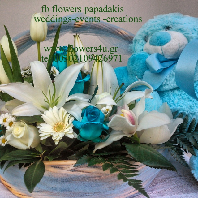 new baby basket with flowers and teddy bear
