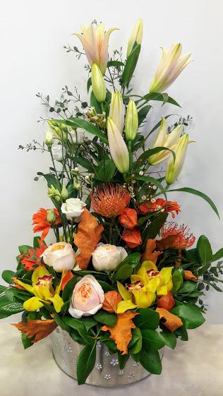 arrangement zink large protea orchids juliet lilium lisianthus
