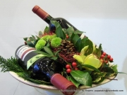 christmas gift with flowers and wines