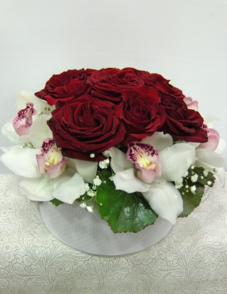 Red Roses and Orchids flowers in round box