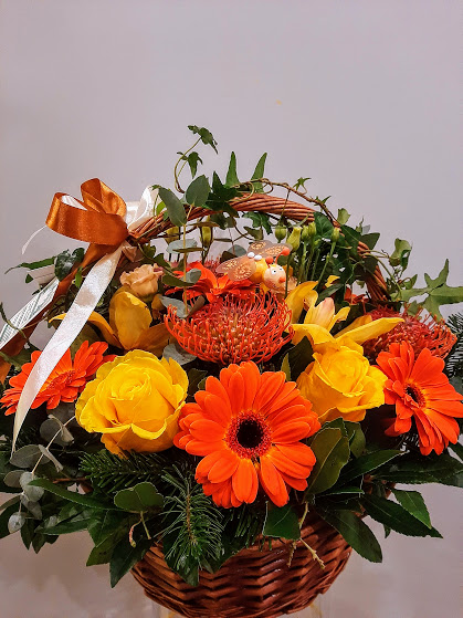 orange and yellow flowers in a basket
